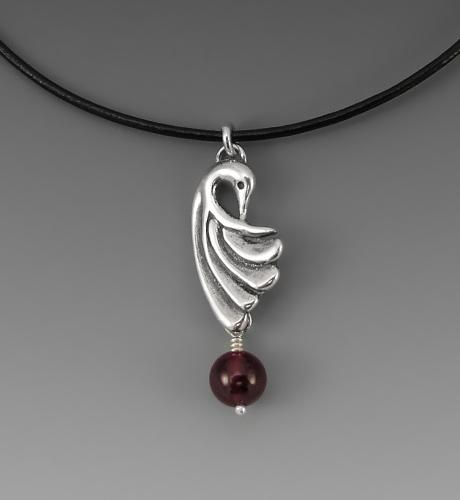 Photo of crane wing pendant